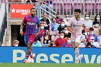 29th August 2021; Nou Camp, Barcelona, Spain; La Liga football league, FC Barcelona versus Getafe;  Memphis Depay of Barca breaks away from Iglesias