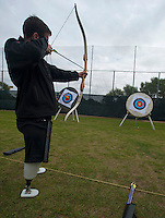 101005-N-7981E-732 SAN DIEGO (October 5, 2010)- British Army Royal Engineer Lance Cpl. Steven Palmer practices archery during the U.S. Olympic Committee's Paralympic Military Sports Camp hosted at Naval Medical Center San Diego. More than 60 injured service men and women from the U.S., British, and Israeli armed forces participated in the four-day event designed to introduce paralympic sport to active duty military personnel and veterans with physical injuries.  (U.S. Navy photo by Mass Communication Specialist 2nd Class James R. Evans / RELEASED)