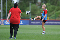 Charlie Estcourt of Wales Women interacts with Wales Homeless squad and school children during the Wales Women post training session at the Cardiff International Sports Stadium in Cardiff, Wales, UK. Monday 03 June 2019