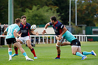 Lewis Wynne of London Scottish makes a reverse pass during the Championship Cup match between London Scottish Football Club and Nottingham Rugby at Richmond Athletic Ground, Richmond, United Kingdom on 28 September 2019. Photo by Carlton Myrie / PRiME Media Images