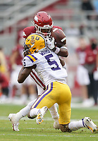 Arkansas running back Trelon Smith (22) fumbles the ball, Saturday, November 21, 2020 during the fourth quarter of a football game at Donald W. Reynolds Razorback Stadium in Fayetteville. Check out nwaonline.com/201122Daily/ for today's photo gallery. <br /> (NWA Democrat-Gazette/Charlie Kaijo)