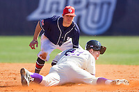 Shortstop Brian Blasik #18 of the Dayton Flyers applies a late tag to Sean Wilson #22 of the High Point Panthers as he steals second base at Willard Stadium on February 26, 2012 in High Point, North Carolina.    (Brian Westerholt / Four Seam Images)