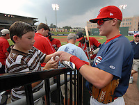 Infielder Kolbrin Vitek (22) of the Greenville Drive signs an autograph prior to a game against the Asheville Tourists on Aug. 26, 2010, at Fluor Field at the West End in Greenville, S.C. Vitek is the Boston Red Sox first round pick in the 2010 draft. Photo by: Tom Priddy/Four Seam Images