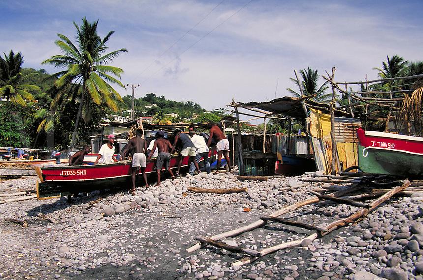 Fishermen & boats in village of Scots Head, island of Dominica , West Indies. Scots Head Village, Dominica West Indies.