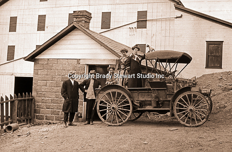 Eastern Ohio:  Brady and Sarah Mathews Stewart and members of Mathews family posing next to the International Harvester Auto Wagon.