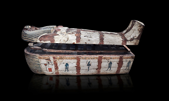 """Ancient Egyptian wooden sarcophagus - the coffin of Puia circa 1800BC - Thebes Necropolis. Egyptian Museum, Turin. Black background<br /> <br /> From about 100BC """"anthropoid """" sarcophagi with fihure shaped lids started to replace rectangular coffins. Pia was probably the son of Puyemre, a high official of Thebes and second priest of Amon under the woman pharoah, Hatshepsut (1479-1458). The sarcophagus was excavated by Robert Mond from a shaft grave found close to the tomb of Puyemre in Thebes Necropolis."""