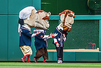 22 June 2014: The Washington Nationals Racing Presidents play a little soccer between innings of a game against the Atlanta Braves at Nationals Park in Washington, DC. The Nationals defeated the Braves 4-1 to split their 4-game series and take sole possession of first place in the NL East. Mandatory Credit: Ed Wolfstein Photo *** RAW (NEF) Image File Available ***