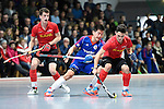 Mannheim, Germany, January 18: During the 1. Bundesliga Herren Hallensaison 2014/15 Sued hockey match between Mannheimer HC (blue) and TSV Mannheim (red) on January 18, 2015 at Irma-Roechling-Halle in Mannheim, Germany. Final score 4-6 (4-4). (Photo by Dirk Markgraf / www.265-images.com) *** Local caption *** Tino Nguyen #7 of Mannheimer HC