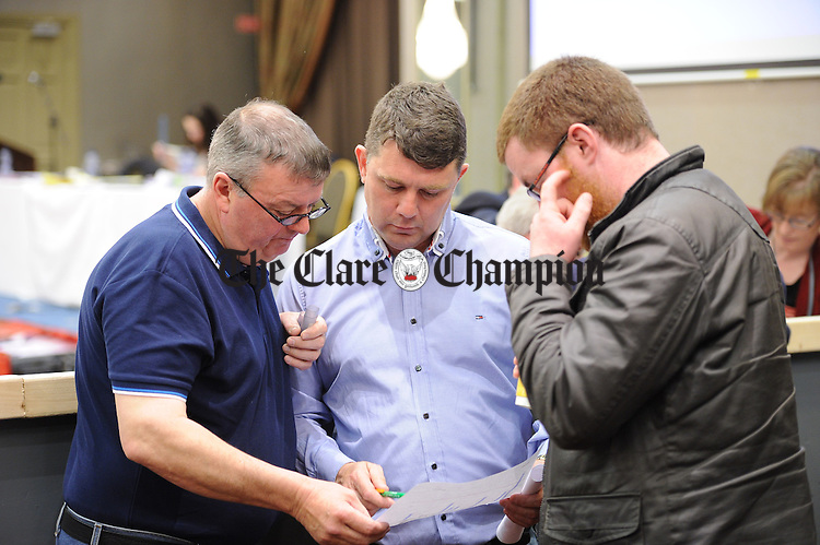 Candidate Pat O Gorman confers with some tally men during the election count at The West county Hotel, Ennis. Photograph by John Kelly.