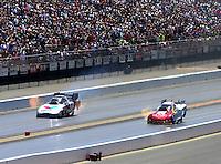 Jul. 27, 2014; Sonoma, CA, USA; NHRA funny car driver Tim Wilkerson (right) races alongside Jack Beckman during the Sonoma Nationals at Sonoma Raceway. Mandatory Credit: Mark J. Rebilas-