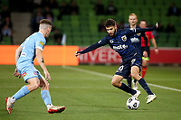 22nd May 2021, Melbourne, Australia;  Daniel De Silva of the Central Coast Mariners cuts inside Melbourne's Scott Galloway during the Hyundai A-League football match between Melbourne City FC and Central Coast Mariners at AAMI Park in Melbourne, Australia.