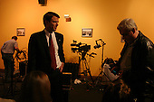 Columbia, South Carolina.USA.February 3, 2004..Senator John Edwards after winning the state of South Carolina greets supporters and does a number of television interviews in a private room. He and his family and staff monitor the election results keeping a sharp eye on Oklahoma which he lost by a very nerrow margin to Clark.
