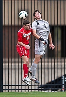 Andy Riemer (20) of Georgetown goes up for a header with Andy Riemer (11) of St. John's during the game at North Kehoe Field in Washington DC. Georgetown defeated St. John's, 2-1, in the Big East conference tournament quarterfinals.