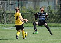 20160827 - ZWEVEZELE , BELGIUM : Zwevezele's Celine Vandekerckhove on her way to the opening goal with Genk's goalkeeper Celien Baeten pictured during the soccer match  in the 2nd round of the  Belgian cup 2017 , a soccer women game between SK Voorwaarts Zwevezele and RC Genk Ladies  , in Zwevezele , saturday 27 th August 2016 . PHOTO SPORTPIX.BE / DIRK VUYLSTEKE