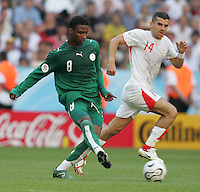 Mohammed Noor, (8) of Saudi Arabia is marked by Adel Chedli (14) of Tunisia. Saudi Arabia and Tunisia played to a 2-2 tie in their FIFA World Cup Group H match at FIFA World Cup Stadium, Munich, Germany, June 14, 2006.