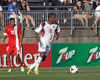 Cuban midfielder Jaime Valencia (8) brings the ball forward.  In CONCACAF Gold Cup Group Stage, the national team of Cuba (white) defeated national team of Belize (red), 4-0, at Rentschler Field, East Hartford, CT on July 16, 2013.