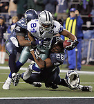 Dallas' Patrick Crayton stretches for a touchdown against Seattle's Jordan Babineaux, left, and Michael Boulware in the second quarter in an NFC Wild-Card game in Seattle on Saturday, January 6, 2007.  (Fort Worth Star-Telegram/Khampha Bouaphanh)