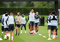 14th September 2021: The  AXA Training Centre , Kirkby, Knowsley, Merseyside, England: Liverpool FC training ahead of Champions League game versus AC Milan on 15th September: Fabinho of Liverpool warms up with his team mates