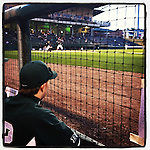 Michigan State players watch the game at Fluor Field from the home dugout. (Tom Priddy/Four Seam Images)