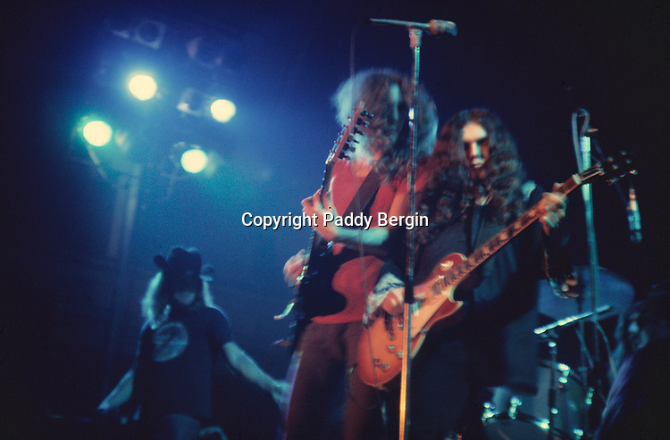 """Lynyrd Skynyrd, Ronnie Van Zant, Allen Collins and Gary Rossington, Dome Brighton 1974.<br /> <br /> Lynyrd Skynyrd is an American rock band best known for popularising the southern hard-rock genre during the 1970s.<br /> <br /> The band rose to worldwide recognition on the basis of its driving live performances and signature tunes """"Sweet Home Alabama"""" and """"Free Bird"""". At the peak of their success, three members died in an airplane crash in 1977, putting an abrupt end to the band's most popular incarnation.<br /> <br /> Stock Photo by Paddy Bergin"""