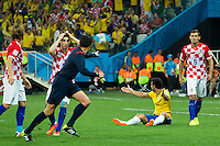 Referee Yuichi Nishimura points to the penalty spot after Fred of Brazil is brought down in the area