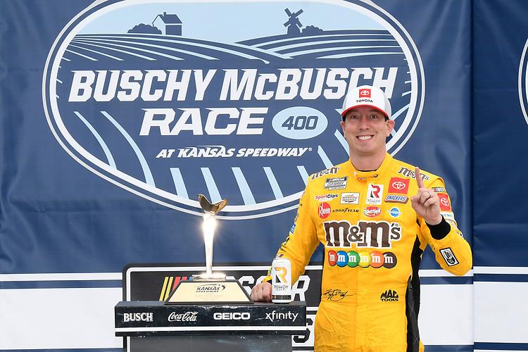#18: Kyle Busch, Joe Gibbs Racing, Toyota Camry M&M's Mix, celebrates after winning in Kansas.