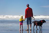 Mother, daughter and dog at Kalalock Beach, Washington Coast, USA