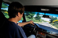 Man driving down a country road during a road trip.