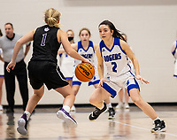 Claudia Bridges (1) of Fayetteville bring ball up the court as Aubrey Treadwell (2) of Rogers presses at King Arena, Rogers, AR January 8, 2021 / Special to NWA Democrat-Gazette/ David Beach