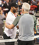 James Blake, USA, (left) defeats John McEnroe (USA) 7-5,  at the PowerShares Champions Cup, in Boston, Massachusetts on April 22, 2015.