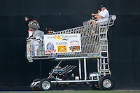 Muddy the Mudcat and his friends drive around the field in a giant shopping cart at Five County Stadium August 15, 2009 in Zebulon, North Carolina. (Photo by Brian Westerholt / Four Seam Images)
