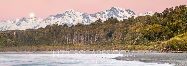 Twilight at Gillespies Beach with moon rising over Fox Glacier and next to Mt. Tasman (left) 3497m and Mt. Cook (right) 3724m, two highest New Zealand mountains, Westland Tai Poutini National Park, West Coast, UNESCO World Heritage Area, New Zealand, NZ
