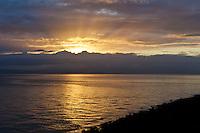 The sun's morning rays turn San Francisco Bay into liquid gold.