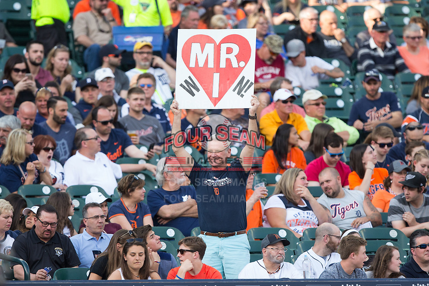 A fan holds a sign imploring the Detroit Tigers to win in memory of their late owner, Mike Ilitch, prior to the game against the Chicago White Sox at Comerica Park on June 2, 2017 in Detroit, Michigan.  The Tigers defeated the White Sox 15-5.  (Brian Westerholt/Four Seam Images)