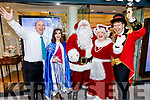 Santa and Mrs Claus arrive at CH Chemist and are greeted by Kevin Riardon, Laura Lee Curtin and Peter Harty.