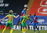 13th March 2021; Selhurst Park, London, England; English Premier League Football, Crystal Palace versus West Bromwich Albion; Luka Milivojevic of Crystal Palace heads the ball above Matheus Pereira of West Bromwich Albion