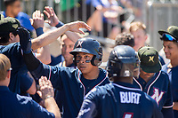 Northwest Arkansas Naturals catcher Xavier Fernandez (34) (center) is congratulated by teammates in the dugout after hitting a home run on May 19, 2019, at Arvest Ballpark in Springdale, Arkansas. (Jason Ivester/Four Seam Images)