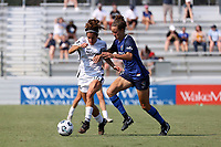 CARY, NC - SEPTEMBER 12: Angela Salem #36 of the Portland Thorns FC is defended by Havana Solaun #19 of the North Carolina Courage during a game between Portland Thorns FC and North Carolina Courage at Sahlen's Stadium at WakeMed Soccer Park on September 12, 2021 in Cary, North Carolina.