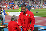 Glasgow 2014 Commonwealth Games<br /> Aled Davies (Wales) collects his silver medal won in the Men's Para-Sport Discus Throw from Anne Ellis.<br /> Hampden Park<br /> 28.07.14<br /> ©Steve Pope-SPORTINGWALES