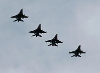 Four Norwegian Lockheed Martin F-16 Fighting Falcon in formation during a display at Rygge Airshow. Norway