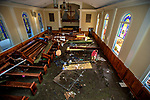 PORT SAINT JOE, FL - OCTOBER 14: Pastor Geoffrey Lentz walks through his sanctuary at the First United Methodist Church after it was gutted by the storm surge from Hurricane Michael on October 14, 2018 in Port Saint Joe, Florida. (Photo by Mark Wallheiser/Getty Images)