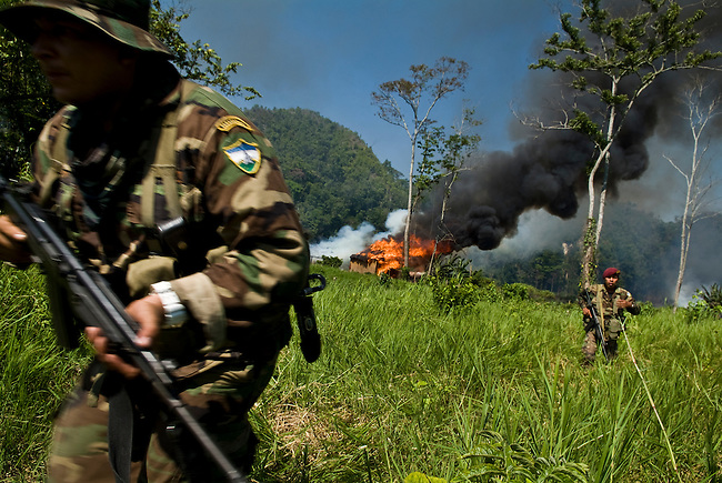 The military clears a village during a forced eviction of an illegal community inside the Mayan Biosphere.