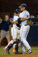Franco Valdes #33 of the Virginia Cavaliers hugs pitcher Kevin Arico #11 after the final out in the championship game of the Charlottesville Regional at Davenport Field on June 5, 2010, in Charlottesville, Virginia.  The Cavaliers defeated the Red Storm 5-3.  Photo by Brian Westerholt / Four Seam Images