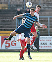 Forfar's Chris Templeman and Stranraer's Jackson Longridge challenge for the ball.