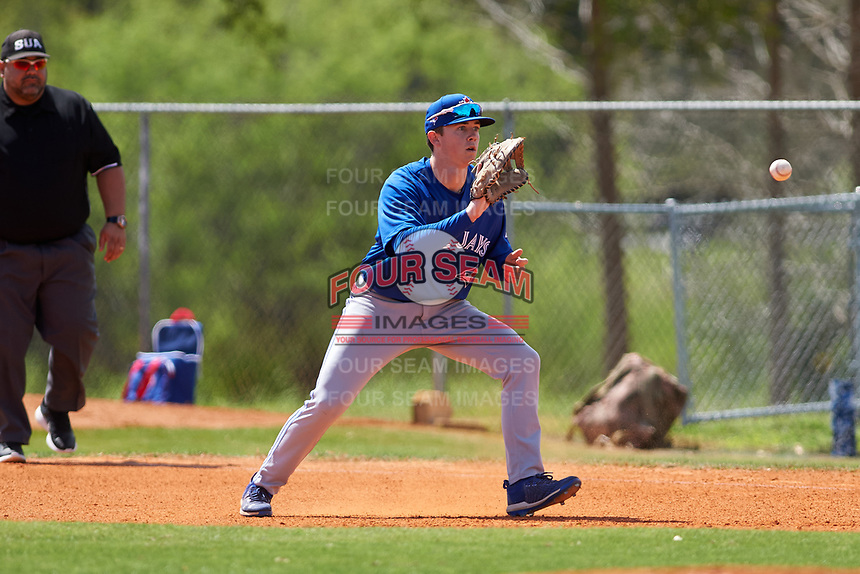 Toronto Blue Jays first baseman PK Morris (8) fields a batted ball during an exhibition game against the Canada Junior National Team on March 8, 2020 at Baseball City in St. Petersburg, Florida.  (Mike Janes/Four Seam Images)
