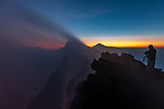 Photographer on the summit of Mount Nyiragongo, Virunga National Park, North Kivu, Democratic Republic of Congo<br /> <br /> Canon EOS 5DS R, EF24-70mm f/4L IS USM lens, f/9 for 2 seconds, ISO 400