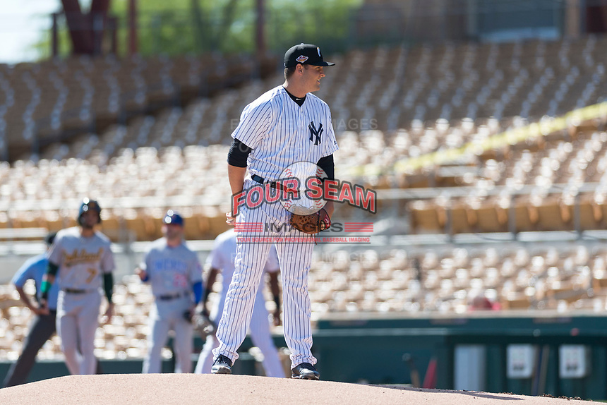 Glendale Desert Dogs relief pitcher Jordan Foley (36), of the New York Yankees organization, looks in for the sign during an Arizona Fall League game against the Mesa Solar Sox at Camelback Ranch on October 15, 2018 in Glendale, Arizona. Mesa defeated Glendale 8-0. (Zachary Lucy/Four Seam Images)