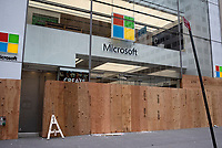 NEW YORK, NEW YORK - JUNE 2: A Microsft store is boarded up after a night of looting on stores due to protest on June 2, 2020 in New York City. Protests spread across the country in at least 30 cities across the United States, over the death of unarmed black man George Floyd at the hands of a police officer, this is the latest death in a series of police deaths of black Americans. New York face it's second night of a curfew (Photo by Joana Toro / VIEWpress via Getty Images)