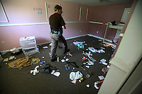 Deputy Rick Booth from the Manassas Sheriff Office in Virginia searches a foreclosed home. He found the house empty, but with the locks changed. The area is suffering from a major collapse in the housing market following the subprime crisis and global credit crunch, which has forced the foreclosure and abandonment of numerous properties...