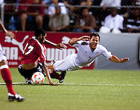 Nicholas Walker (17) slide tackles Danny Cruz (7). US Under 20 Men's National Team played to a scoreless draw vs Trinidad & Tobago, advancing after winning 4-3 on penalty kicks at the Marvin Lee Stadium in Macoya, Trinidad on March 13th, 2009 during the 2009 CONCACAF U-20 Championship.
